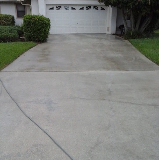 Concrete Driveway with sealer, Fort Myers Pressure Washing, Naples Pressure Cleaning, Bonita Springs Pressure Cleaners, Cape Coral Pressure Cleaners, Fort Myers Paver Cleaning and Sealing, Naples Paver Cleaning and Sealing